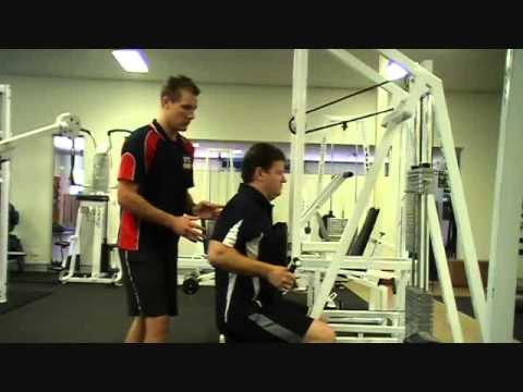 FITCollege - http://www.FitCollege.edu.au/ Today our Fit College Trainer Mark, shows Matt how to use the Bilateral Seated Row. Discover what muscles this exercise uses. I...