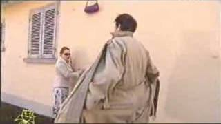 A lady slips and her handbag gets caught on a hook.  She gets help from a most unexpected source.