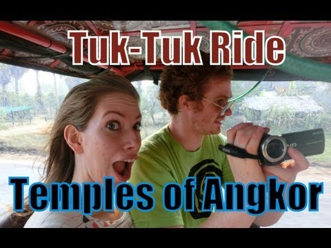 Taking a tuk-tuk ride around the temples of Angkor, Cambodia