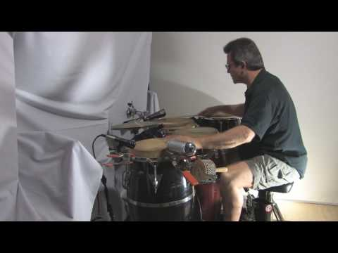 Larry Marc Aurele percussion & congas on Son C~