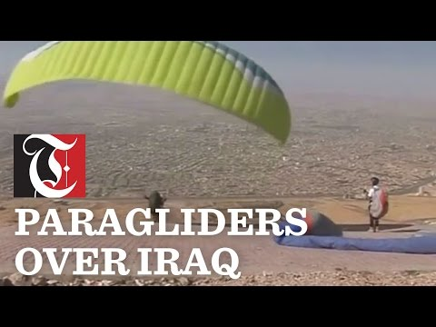 Paragliders sail through the skies above Sulaimaniya in Iraq, calling on the government to help organize a national team to compete as the country tries to revive activities that were common before the 2003 war.