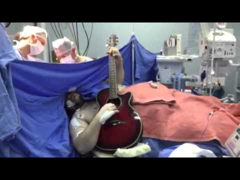 Brazilian man Plays Guitar And Sings The Beatles on his guitar during BRAIN