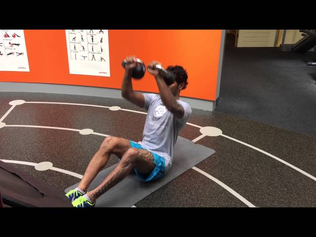 MMA MUSCLES - Sit up combined with a kettlebell chest press