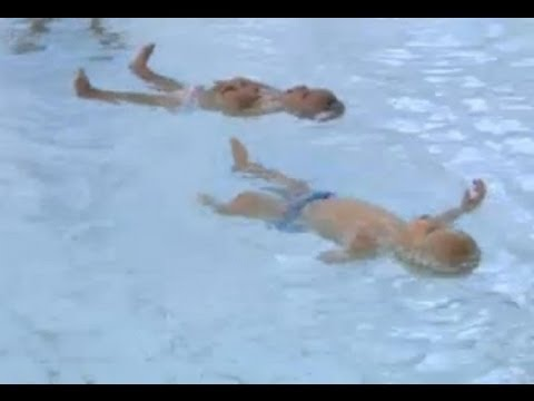 9-Month-Old Twin Babies Swim a 25-Meter Pool Length