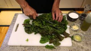 How to Cook Swiss Chard with Garlic - Episode 100IngredientsSwiss Chard – 1 bunchOlive Oil – 2 TGarlic – 2 cloves – smashed and choppedLemon – 1 small – juiced (to taste)Kosher SaltPepper Wash and separate stems from leaves.Chop stems into 1 inch segmentsChop leaved into 1 inch ribbonsHeat 2 T oilAdd stems – cook for 5-10 minutes till softAdd leaves – cook till wiltedAdd chopped garlic – 30 secondsAdd lemon juice to tasteTake off heat