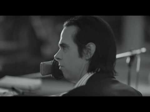 One More Time With Feeling (2016) is a beautiful and heartbreaking film about Nick Cave coping with the death of his teenage son as he's recording the album Skeleton Tree.