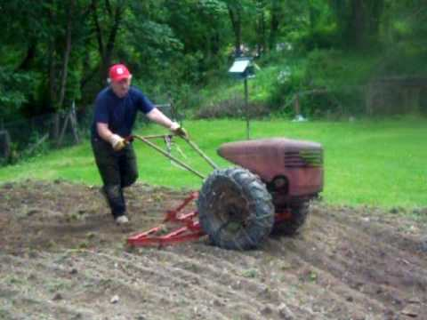 david bradley tractor - Just finishing up the garden wanted to show those who are not familiar with them, how the attachments hook up , and the Spike tooth Harrow at work.