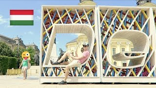 ► Facebook Group: http://bit.ly/MagyarWeasels► Meet-Up Information: http://bit.ly/MagyarMeetUp---- ↓↓↓ Click 'SHOW MORE' below to see more information ↓↓↓► Feliratkozás: http://bit.ly/TravellingWeasels► Subscribe: http://bit.ly/TravellingWeaselsWe have arrived in Hungary! Not only that, but we had the BEST arrival we have ever had! If you haven't seen it yet, watch Vlog number one here: http://bit.ly/HungaryVlogs2017 Today we spoke some Hungarian in Debrecen! Special thanks to our Couchsurfing hosts! Join our Facebook Group for more information on upcoming meet-ups: http://bit.ly/MagyarWeasels Also, read the blog post for all our meet-up dates: http://bit.ly/MagyarMeetUpHave you seen all the 'Speaking Hungarian' videos? Watch them now:PART 1: https://youtu.be/FsKQEPJXKJMPART 2 Megszentségteleníthetetlenségeskedéseitekért: https://youtu.be/-IXg4NR9zaUPART 3 Hungarian Tongue Twisters: https://youtu.be/VXS0RLTm8_gPART 4 A Magyar ÁBÉCÉ: https://youtu.be/MnU7jC7QJAMPART 5 ANGOLOK MAGYARUL: https://youtu.be/RgI88oSpYlIPART 6 NEMZETI ÜNNEP: https://youtu.be/_hspDZgFcOUPART 7 SZÁMOK: https://youtu.be/QeXL5r6AcFUPART 8 KASSZÁS ERZSI: https://youtu.be/4l_iKWieOd0PART 9 ÁLLATOK: https://youtu.be/ds-Q7uPlFnUPART 10 MAGYAR YOUTUBERS: https://youtu.be/0KwPpTBh4pIPART 11 MAGYAR MUSIC: https://youtu.be/WTLwXYxecdkPART 12 ÉTEL: https://youtu.be/H6TVecbZTggPART 13 JOCI PÁPAI: https://youtu.be/DxMrycK-aVIPART 14 MAGYAR APP: https://youtu.be/YQeYLQ0h7JMPART 15 MAGYAR ROCK: https://youtu.be/fxVcwjJxASM PART 16 TMI TAG: https://youtu.be/uqiBJ0eu9OsPART 17 YOUTUBERS: https://youtu.be/SE4t8Y3-82kPART 18 TALÁMÁNYOK: https://youtu.be/alTZQydU__MPART 19 PALVIN BARBARA: https://youtu.be/aabjW0tDi10► Watch our Hungary Playlist here (WE VISITED HUNGARY!): http://bit.ly/HungaryPlaylist 🇭🇺► All Speaking Hungarian Videos: https://youtu.be/FsKQEPJXKJM?list=PLd5RMUGwfy3ss-4hQ6sHOxGLMPOTtu_89► Binge-watch our videos to get to know us: http://bit.ly/Binge-Watch-Now► Watch our Challenges Playlist here: 