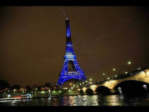 The Eiffel Tower lights up with messages of hope on November 29.