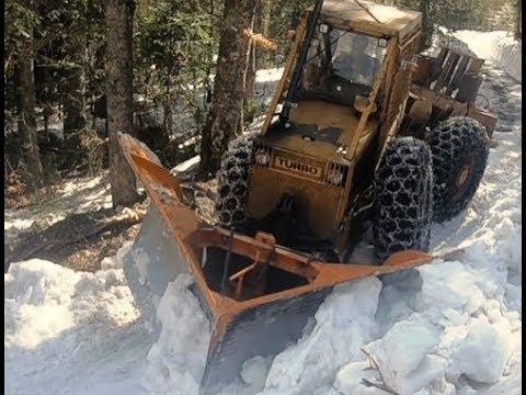 Skidder  LKT with Snowplow destroying Snowdrifts!