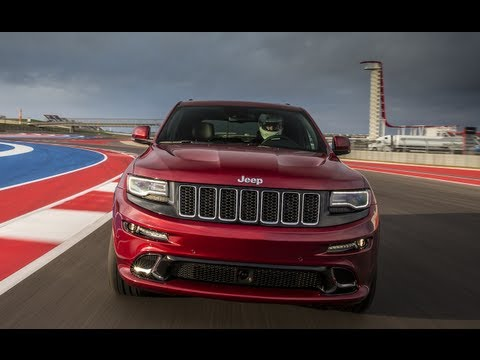 srt - http://www.TFLcar.com ) The 2014 Jeep Grand Cherokee SRT is a 470 horsepower all-wheel-drive performance machine. But how does the new 2014 Jeep Grand Cher...