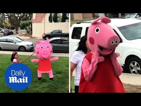 Hilarious moment little year girl furiously hits Peppa Pig piñata - Daily Mail