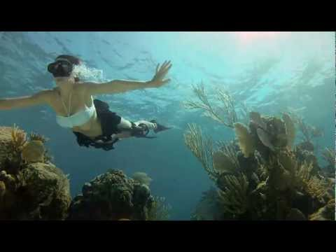 (HD - Shot 100% on the new Dive Housing & HD HERO2® camera from http://GoPro.com Wingsuit base jumper and Italian phenom Roberta Mancino and pro surfer & world ren...