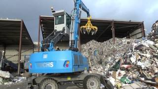 Terex Fuchs MHL 320 material handler loading waste into a Doppstadt DW 3060 Bio Power shredder