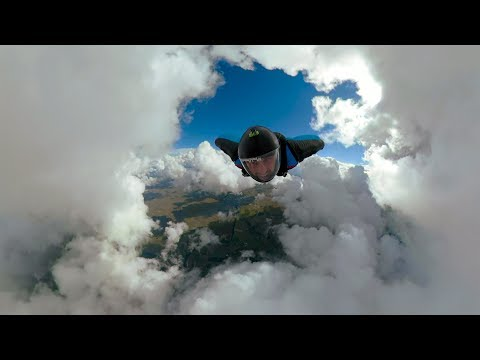 Wingsuit Jump Through Clouds