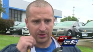 Brian Darby had gone to Coach's Bar & Grill to check on flooding at the business when he and a woman became trapped by the water.Subscribe to KMBC on YouTube now for more: http://bit.ly/1fXGVrhGet more Kansas City news: http://kmbc.comLike us:http://facebook.com/kmbc9Follow us: http://twitter.com/kmbcGoogle+: http://plus.google.com/+KMBC