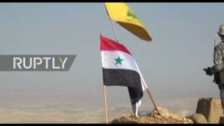 Troops of the Syrian Arab Army (SAA) scored further gains on the western slopes of the Qalamoun Mountains, Monday, in a joint offensive alongside Hezbollah fighters targeting positions in the control of self-proclaimed Islamic State (Is; formerly ISIL/ISIS) and al-Nusra Front.The SAA and Hezbollah fighters were able to seize control over several strategic areas, including the Faleeta Barrens and the height of Tal Burkan on the Syrian-Lebanese border.Video ID: 20170725 015Video on Demand: http://www.ruptly.tvContact: cd@ruptly.tvTwitter: http://twitter.com/RuptlyFacebook: http://www.facebook.com/Ruptly
