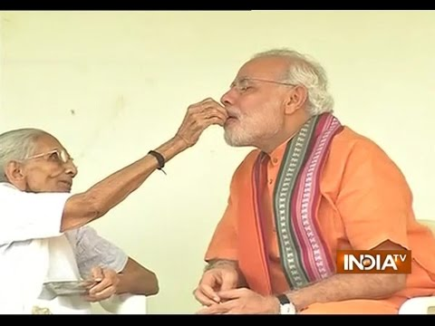 his - Subscribe to Official India TV YouTube channel here: http://goo.gl/5Mcn62 Prime Minister Narendra Modi on Wednesday morning sought the blessings of his mother Hiraba on the occasion of his...
