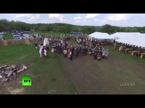 A Russian Man Armed With a Spear Takes Down Flying Drone at a History Festival in