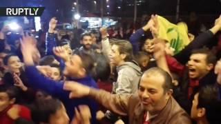 Сирийцы празднуют освобождение Алеппо от боевиков