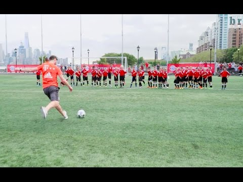 Bayern Munich's Xabi Alonso and Arturo Vidal vs. 40 children