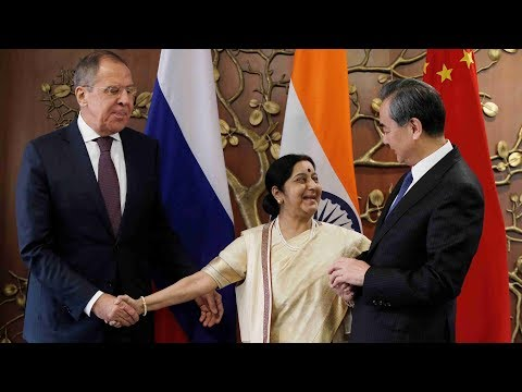 Russia, India and China push trilateral cooperation at RIC forum