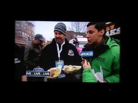 East Rutherford tailgate with food coverage.