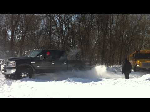 Ford F250 pulls school bus out of snow