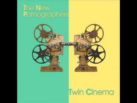 Tekst piosenki The New Pornographers - Twin Cinema po polsku