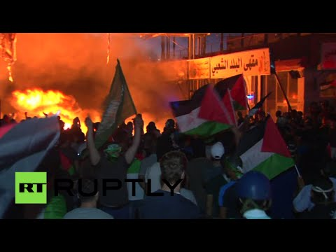 West Bank turmoil%3A Thousands of Palestinians protest Israeli offensive