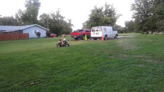 8. SunL 90 4 wheeler and a 6 year old playing