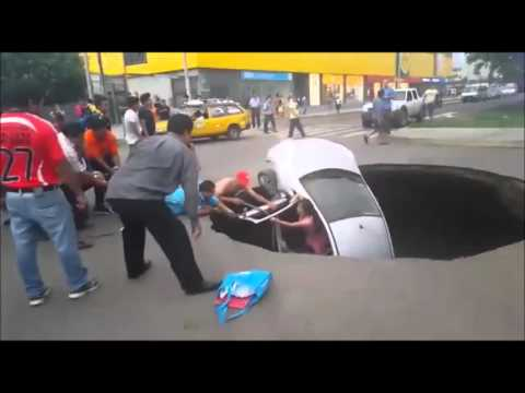 WATCH: Family Rescued From Their Car That Was By A Sinkhole