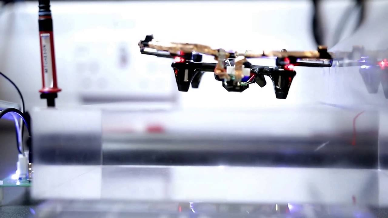 Transferring power wirelessly to a battery-less quadrotor drone