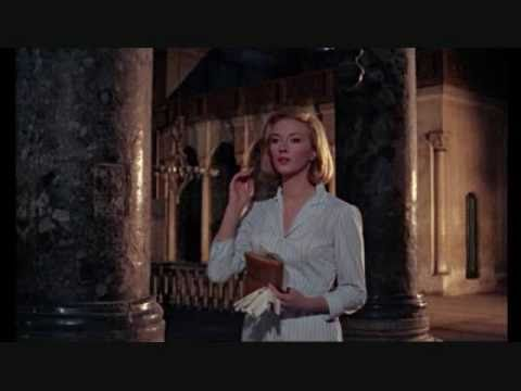 Tekst piosenki John Barry - Bond Meets Tania po polsku