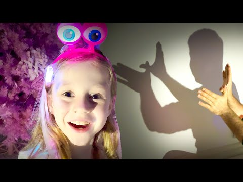 Nastya plays with shadow puppets and glowing toys