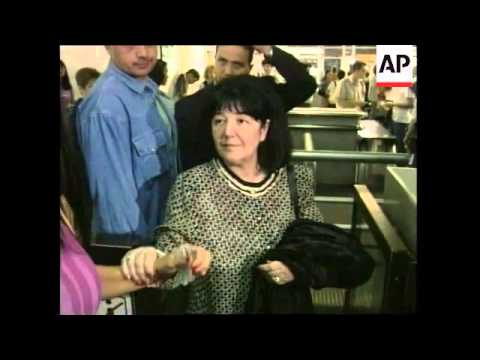 Milosevic's wife leaves for the Hague for visit.