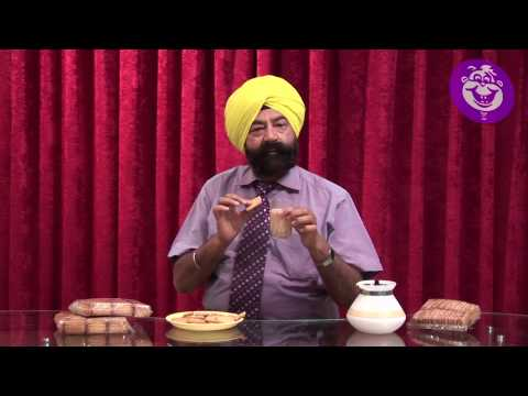 How to eat ATTA BISCUITS ??? Tutorial by Jaspal Bhatti - YouTube