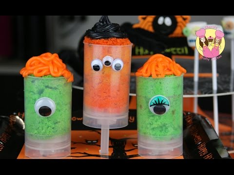 crafty - Halloweeen Monster push pops Ingredients Push pop containers Green cake (vanilla cake with green food dye) Purple frosting Piping bag with grass piping tip S...