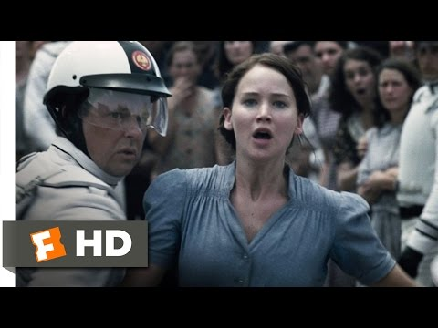 TheHungerGamesMovie - The Hunger Games Movie Clip - watch all clips http://j.mp/18UG0Fx click to subscribe http://j.mp/sNDUs5 Katniss Everdeen (Jennifer Lawrence) volunteers as tr...
