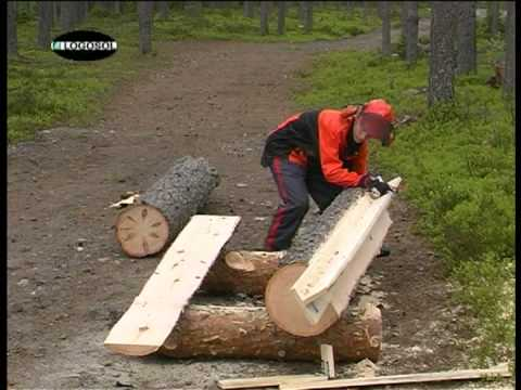 Chainsaw - Stihl chainsaw on a portable sawmill from Logosol cutting boards from a log, just like an Alaskan mill. The adventage is that you not only get rough edged bo...
