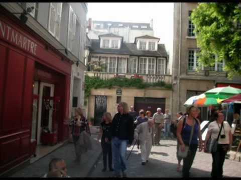 Paris en chansons - Montand  Aznavour et Reggiani