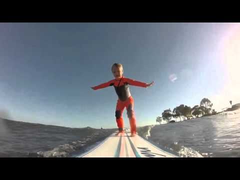 4 Year Old Girl Experiences The Joys of Surfing..Her face Says it all