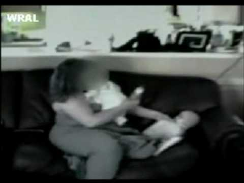 abuse - A woman caught on tape ill-treating twin babies. Absolutely terrible!