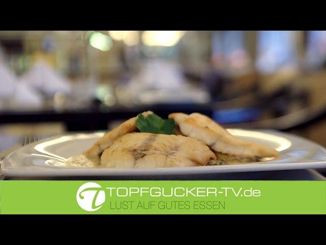 Hamburger Pannfisch vom Schellfisch auf Bratkartoffeln und Dijonsenf Sauce