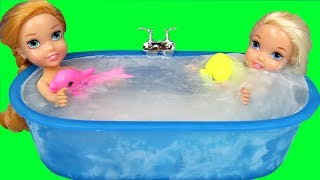 Bath FREEZING Accident !  Elsa & Anna toddlers trapped in ICE ! Bubbles - Foam - Messy floor - Fight