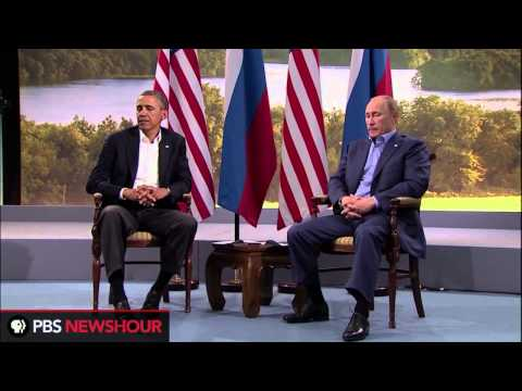 russian; - U.S. President Barack Obama and Russian President Vladimir Putin spoke together at the G8 conference.
