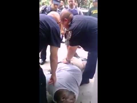 Video! - Eric Garner laying on ground not breathing for over 5 minutes, no resuscitation, he is placed on stretcher and taken into ambulance. AT 6:56 The Officer Who ...