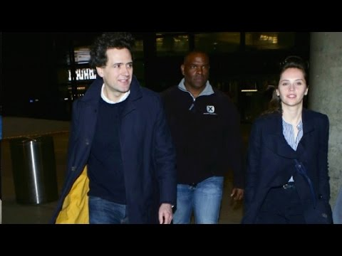 Felicity Jones And Boyfriend Charles Guard In Matching Navy At LAX