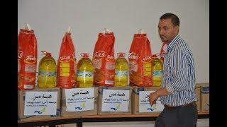 أجواء من حفل تسليم مساعدات غذائية و مالية