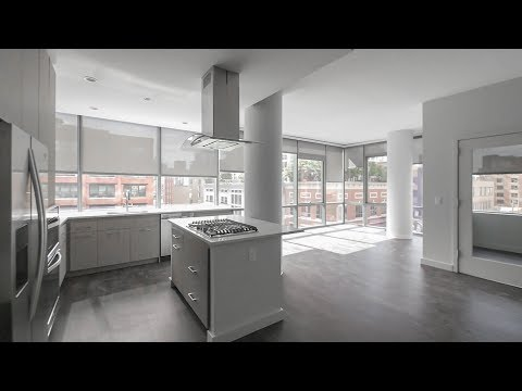 Tour a 2-bedroom plus den, 2-bath in an exciting River North location